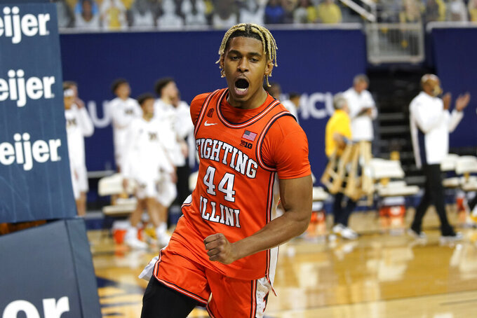 Illinois guard Adam Miller reacts to a basket against Michigan in the second half of an NCAA college basketball game in Ann Arbor, Mich., Tuesday, March 2, 2021. (AP Photo/Paul Sancya)
