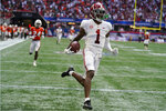 Alabama wide receiver Jameson Williams (1) scores after a catch during the second half of an NCAA college football game against Miami, Saturday, Sept. 4, 2021, in Atlanta. (AP Photo/John Bazemore)