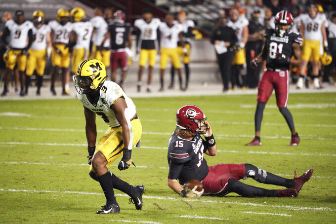Missouri safety Martez Manuel (3) celebrates a sack of South Carolina quarterback Collin Hill (15) during the first half of an NCAA college football game Saturday, Nov. 21, 2020, in Columbia, S.C. (AP Photo/Sean Rayford)