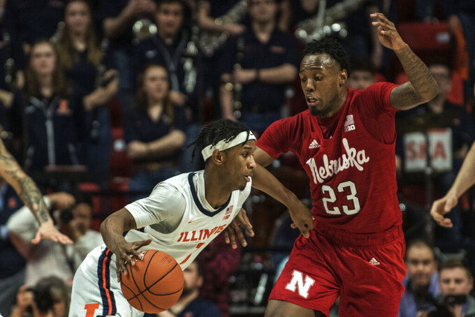 Illinois' Trent Frazier (1) drives past Nebraska's Jervay Green (23) in the second half of an NCAA college basketball game Monday, Feb. 24, 2020, in Champaign, Ill. (AP Photo/Holly Hart)