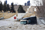 A semi truck and trailer are swept off the road by floodwaters Thursday, March 13, 2019, in Arlington, Neb. Evacuations forced by flooding have occurred in several eastern Nebraska communities, as western Nebraska residents struggled with blizzardlike conditions. (Ryan Soderlin/Omaha World-Herald via AP)