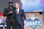 Vanderbilt cornerback Joejuan Williams poses with NFL Commissioner Roger Goodell after the New England Patriots selected Williams in the second round of the NFL football draft, Friday, April 26, 2019, in Nashville, Tenn. (AP Photo/Mark Humphrey)
