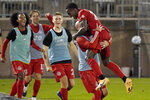 Toronto FC's Richie Laryea, right, celebrates his goal with his teammates during the second half of an MLS soccer match, Sunday, Sept. 27, 2020, in East Hartford, Conn. (AP Photo/Jessica Hill)