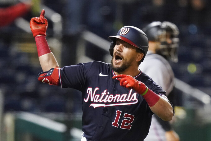Washington Nationals' Kyle Schwarber celebrates as he runs the bases for his two-run game-winning homer during the tenth inning of a baseball game against the Miami Marlins at Nationals Park, Friday, April 30, 2021, in Washington. The Nationals won 2-1 in 10 innings. (AP Photo/Alex Brandon)