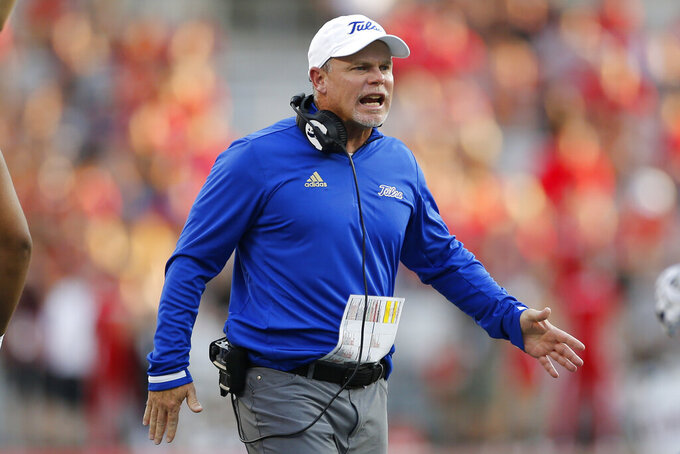 Tulsa head coach Phillip Montgomery instructs his team during the second half of an NCAA college football game against Ohio State, Saturday, Sept. 18, 2021, in Columbus, Ohio. (AP Photo/Jay LaPrete)