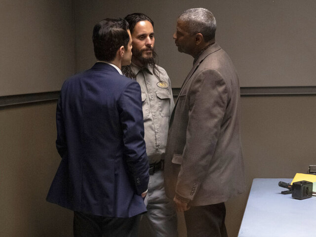 This image released by Warner Bros. Pictures shows Rami Malek, from left, Jared Leto and Denzel Washington in a scene from