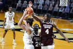 Mississippi State guard Cameron Matthews (4) tries to knock the ball away from Vanderbilt forward Quentin Millora-Brown (42) in the first half of an NCAA college basketball game Saturday, Jan. 9, 2021, in Nashville, Tenn. (AP Photo/Mark Humphrey)