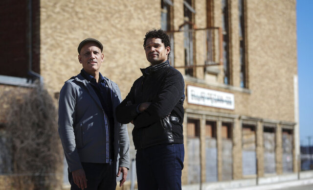 Daniel Banks, left, and Adam McKinney of DNAWORKS created the 1012 Leadership Coalition, which includes five local organizations, to save the former Ku Klux Klan Hall and transform it into an international center for arts and community healing. (Amanda McCoy/Star-Telegram via AP)