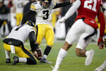Iowa kicker Keith Duncan (3) kicks the winning field goal with punter Colten Rastetter (7) holding during the second half of an NCAA college football game against Nebraska in Lincoln, Neb., Friday, Nov. 29, 2019. Iowa won 27-24. (AP Photo/Nati Harnik)