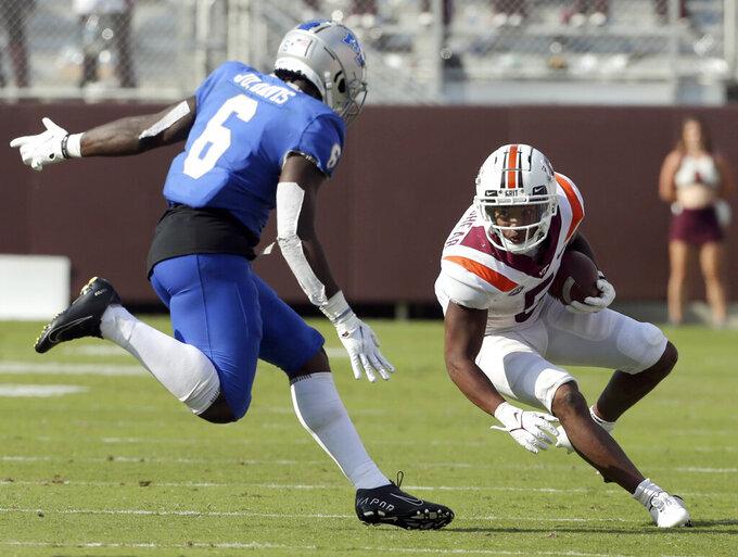 Virginia Tech running back Raheem Blackshear (5) attempts to evade Middle Tennessee linebacker Jurriente Davis (6) in the second half of an NCAA college football game, Saturday, Sept. 11, 2021, in Blacksburg Va. (AP Photo/Matt Gentry)