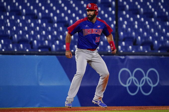 Dominican Republic's Jose Bautista lead off third base during a baseball game against South Korea at the 2020 Summer Olympics, Sunday, Aug. 1, 2021, in Yokohama, Japan. (AP Photo/Sue Ogrocki)