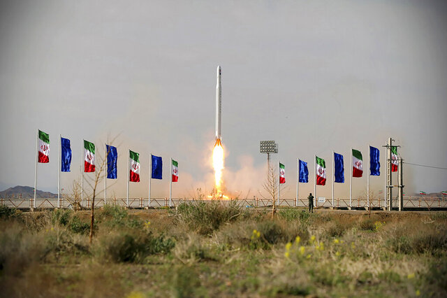 In this photo released Wednesday, April 22, 2020, by Sepahnews, an Iranian rocket carrying a satellite is launched from an undisclosed site believed to be in Iran's Semnan province. Iran's Revolutionary Guard said Wednesday it put the Islamic Republic's first military satellite into orbit, dramatically unveiling what experts described as a secret space program with a surprise launch that came amid wider tensions with the United States. (Sepahnews via AP)