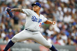 Los Angeles Dodgers relief pitcher Julio Urias works against the Colorado Rockies in the seventh inning of a baseball game Sunday, June 30, 2019, in Denver. (AP Photo/David Zalubowski)