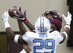 Virginia Tech's Damon Hazelton, rear, catches an 11-yard touchdown pass as North Carolina's Storm Duck (29) defends in the second quarter of an NCAA college football game Saturday, Oct. 19 2019, in Blacksburg Va. (Matt Gentry/The Roanoke Times via AP)
