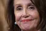 House Speaker Nancy Pelosi, D-Calif., stands at a Democratic event ahead of a House floor vote on the Health Care and Prescription Drug Package, at the Capitol in Washington, Wednesday, May 15, 2019. Earlier, at the National Peace Officers Memorial Day service, Attorney General William Barr asked Pelosi,