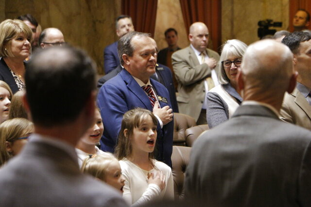 A home school choir sings the national anthem on the House floor before a joint session of the Legislature on Tuesday, Jan. 14, 2014 in Olympia, Wash. Lawmakers convened the joint session to hear Gov. Jay Inslee's State of the State address. (AP Photo/Rachel La Corte)