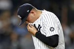 New York Yankees pitcher Sal Romano walks to the dugout during the seventh inning of the team's baseball game against the Toronto Blue Jays on Thursday, Sept. 9, 2021, in New York. (AP Photo/Adam Hunger)