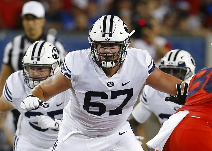 FILE - Brigham Young offensive lineman Brady Christensen (67) is shown in action in the first half during an NCAA college football game against Arizona in Tucson, Ariz., in this Saturday, Sept. 1, 2018, file photo. Christensen was selected to The Associated Press All-America first-team offense, Monday, Dec. 28, 2020. (AP Photo/Rick Scuteri)