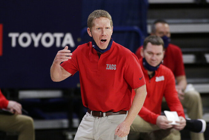Gonzaga coach Mark Few speaks to an official during the second half of the team's NCAA college basketball game against Northern Arizona in Spokane, Wash., Monday, Dec. 28, 2020. Gonzaga won 88-58. (AP Photo/Young Kwak)