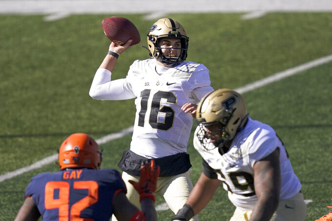Purdue quarterback Aidan O'Connell (16) passes during the first half of an NCAA college football game against Illinois Saturday, Oct. 31, 2020, in Champaign, Ill. (AP Photo/Charles Rex Arbogast)