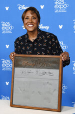 Television personality Robin Roberts poses during her handprint ceremony at the Disney Legends press line during the 2019 D23 Expo, Friday, Aug. 23, 2019, in Anaheim, Calif. (Photo by Chris Pizzello/Invision/AP)