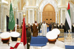 In this Wednesday, Nov. 27, 2019, photo released by Ministry of Presidential Affairs, Saudi Crown Prince Mohammed bin Salman, center left, attends a cremony with Abu Dhabi Crown Prince Mohammed bin Zayed Al Nahyan at Qasr Al Watan in Abu Dhabi, United Arab Emirates. Saudi crown prince is in the United Arab Emirates for talks that are expected to focus on the war in Yemen and tensions with Iran. (Ryan Carter/Ministry of Presidential Affairs via AP)