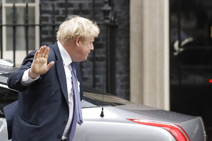 Britain's Prime Minister Boris Johnson arrives at 10 Downing Street in London, Thursday, Feb. 13, 2020. British Prime Minister Boris Johnson shook up his government on Thursday, firing and appointing ministers to key Cabinet posts. Johnson was aiming to tighten his grip on government after winning a big parliamentary majority in December's election. That victory allowed Johnson to take Britain out of the European Union in January. (AP Photo/Matt Dunham)