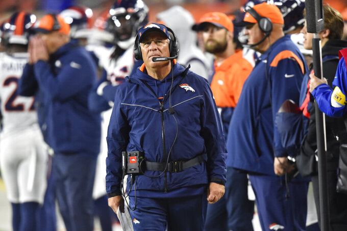 Denver Broncos coach Vic Fangio looks up during the first half of the team's NFL football game against the Cleveland Browns, Thursday, Oct. 21, 2021, in Cleveland. (AP Photo/David Richard)
