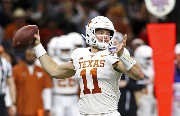 Texas quarterback Sam Ehlinger (11) throws a pass during the first half of the team's Sugar Bowl NCAA college football game against Georgia in New Orleans, Tuesday, Jan. 1, 2019. (AP Photo/Rusty Costanza)