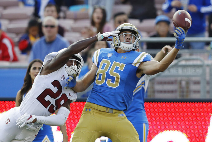 UCLA tight end Greg Dulcich (85) fails to make a one-handed catch as Stanford cornerback Kendall Williamson (29) defends during the second half of an NCAA college football game Saturday, Nov. 24, 2018, in Pasadena, Calif. (AP Photo/Marcio Jose Sanchez)