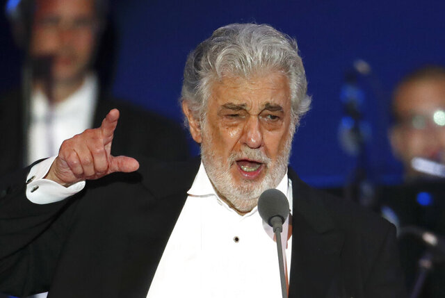 FILE- In this Aug. 28, 2019, file photo, opera singer Placido Domingo performs during a concert in Szeged, Hungary.  In an interview published Wednesday Dec. 4, 2019, in a leading Spanish newspaper, Domingo has sought to blame allegations of sexual harassment against him, on cultural differences between countries. (AP Photo/Laszlo Balogh, File)
