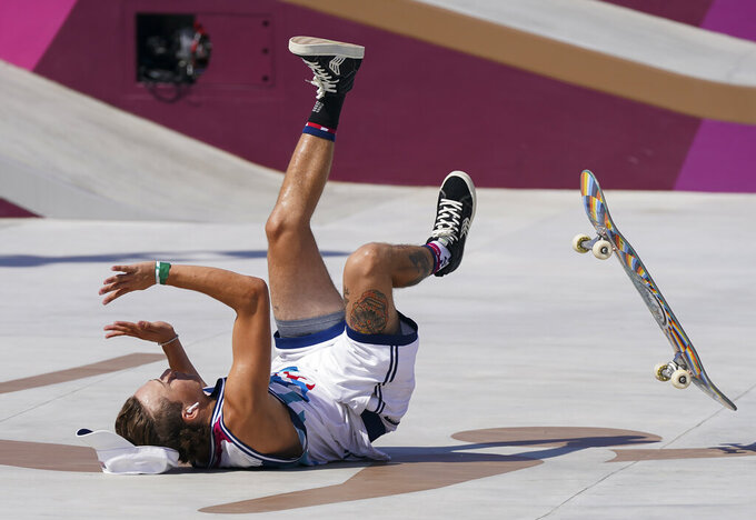 Jagger Eaton, of the United States, crashes as he competes in men's street skateboarding during the Tokyo Olympics in Tokyo on Sunday, July 25, 2021. (Nathan Denette/The Canadian Press via AP)