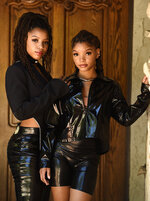 In this May 28, 2020 photo, Chloe Bailey, left, and her sister Halle Bailey, of the R&B duo Chloe X Halle, pose for a portrait in their backyard in Los Angeles to promote their latest release,
