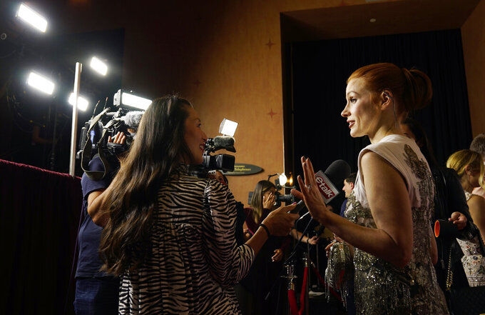 """Jessica Chastain, star of """"The Eyes of Tammy Faye,"""" works the press line at the premiere of the film at the 2021 Toronto International Film Festival, Sunday, Sept. 12, 2021, in Toronto. (AP Photo/Chris Pizzello)"""