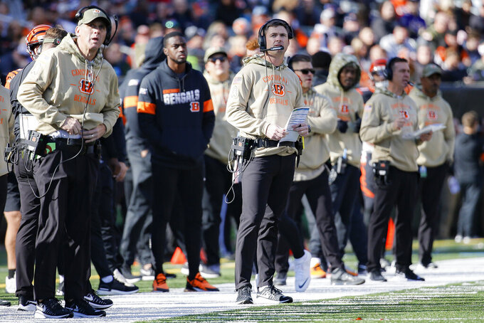 Cincinnati Bengals head coach Zac Taylor, center, works the sidelines during the first half of NFL football game against the Baltimore Ravens, Sunday, Nov. 10, 2019, in Cincinnati. (AP Photo/Frank Victores)