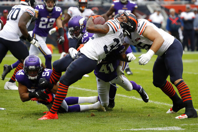 Chicago Bears running back David Montgomery (32) runs with the ball as Minnesota Vikings middle linebacker Eric Kendricks (54) defends during the half of an NFL football game Sunday, Sept. 29, 2019, in Chicago. (AP Photo/Charles Rex Arbogast)