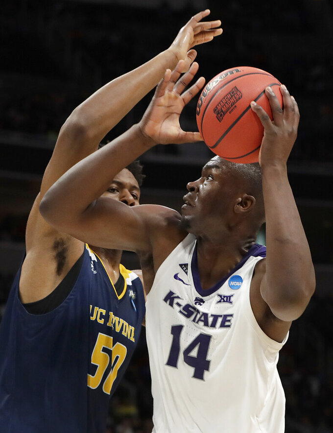 Kansas State forward Makol Mawien, right, shoots against UC Irvine forward Elston Jones during the first half of a first round men's college basketball game in the NCAA Tournament Friday, March 22, 2019, in San Jose, Calif. (AP Photo/Chris Carlson)