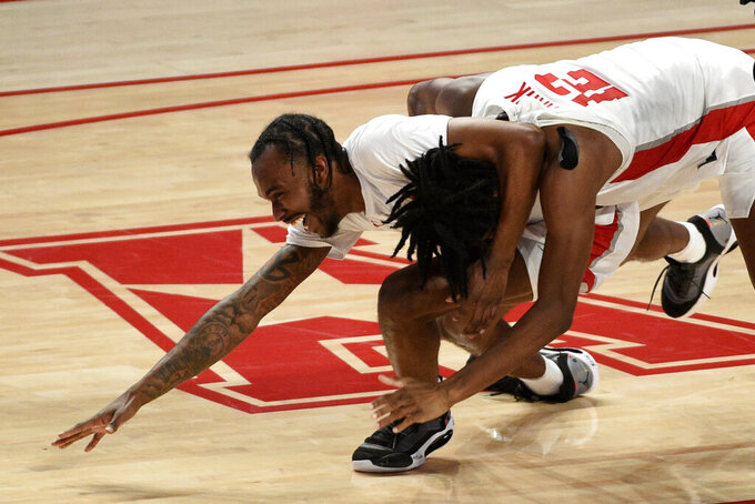 Houston guard Tramon Mark, right, celebrates his game-winning 3-point basket with DeJon Jarreau during the second half of an NCAA college basketball game against Memphis, Sunday, March 7, 2021, in Houston. (AP Photo/Eric Christian Smith)
