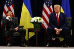 FILE In this file photo taken on Wednesday, Sept. 25, 2019, U.S. President Donald Trump meets with Ukrainian President Volodymyr Zelenskiy at the InterContinental Barclay New York hotel during the United Nations General Assembly, in New York. Ukraine's president sits down Monday, Dec. 9, 2019 for peace talks in Paris with Russian President Vladimir Putin in their first face-to-face meeting, and the stakes could not be higher. More than five years of fighting in eastern Ukraine between government troops and Moscow-backed separatists has killed more than 14,000 people, and a cease-fire has remained elusive.  (AP Photo/Evan Vucci, File)