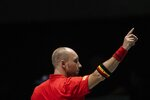 Belgium's Steve Darcis gestures during the Davis Cup tennis match against Colombia's Santiago Giraldo in Madrid, Spain, Monday, Nov. 18, 2019. (AP Photo/Bernat Armangue)