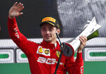 Ferrari driver Charles Leclerc of Monaco celebrates on podium after winning the Formula One Italy Grand Prix at the Monza racetrack, in Monza, Italy, Sunday, Sept.8, 2019. (AP Photo/Antonio Calanni)