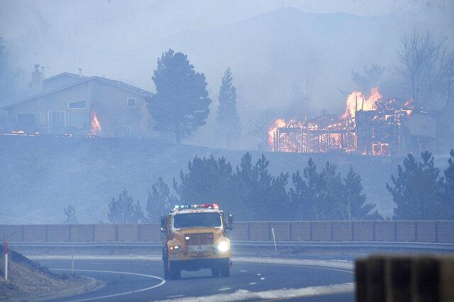Firefighters battle the Pinehaven Fire in the Caughlin Ranch area of Reno, Nev., on Tuesday, Nov. 17, 2020. (Jason Bean/The Reno Gazette-Journal via AP)