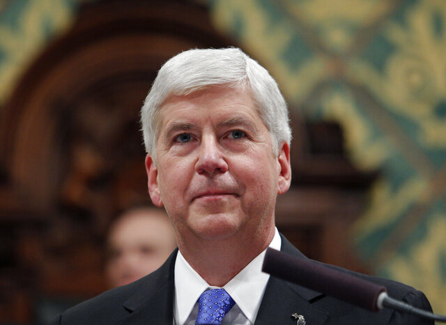 FILE - In this Jan. 23, 2018, file photo Michigan Gov. Rick Snyder delivers his State of the State address to a joint session of the House and Senate at the state Capitol in Lansing, Mich. Former Michigan governor Snyder backed Joe Biden for president on Thursday, Sept. 3, 2020, becoming the latest high-profile Republican to support the Democratic nominee over President Donald Trump. (AP Photo/Al Goldis, File)