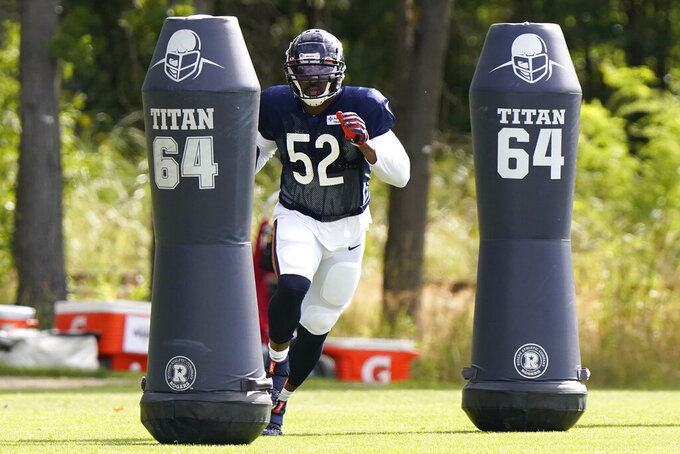 FILE - Chicago Bears linebacker Khalil Mack runs a drill during an NFL football camp practice in Lake Forest, Ill., Tuesday, Aug. 18, 2020. NFL teams can always use more pass rushers, as evidenced by the NFC North where all four teams have spent big to acquire them over the last three years. (AP Photo/Nam Y. Huh, Pool, File)