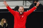 Utah head coach Larry Krystkowiak motions to his players during the first half of an NCAA college basketball game against Washington in the first round of the Pac-12 men's tournament Wednesday, March 10, 2021, in Las Vegas. (AP Photo/John Locher)