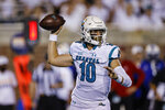 Coastal Carolina quarterback Grayson McCall prepares to throw a pass against Kansas during the first half of an NCAA college football game in Conway, S.C., Friday, Sept. 10, 2021. (AP Photo/Nell Redmond)