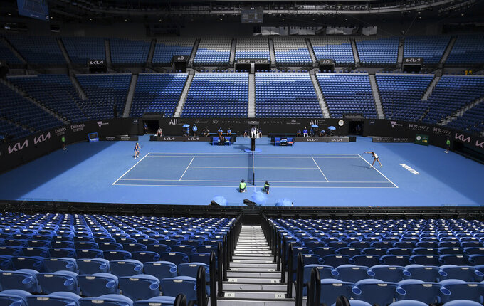 Karolina Muchova of the Czech Republic and compatriot Karolina Pliskova play in an empty Rod Laver Arena during their third round match at the Australian Open tennis championship in Melbourne, Australia, Saturday, Feb. 13, 2021. The Australian Open continues but without crowds after the Victoria state government imposed a five-day lockdown starting Saturday in response to a COVID-19 outbreak at a quarantine hotel.(AP Photo/Andy Brownbill)