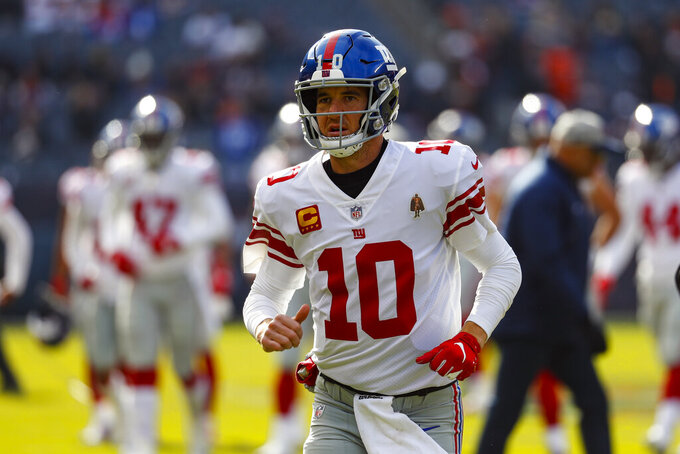 "FILE - In this Nov. 24, 2019, file photo, New York Giants quarterback Eli Manning (10) is shown before an NFL football game against the Chicago Bears, in Chicago. Giants quarterback Daniel Jones was kept out of practice Wednesday, Dec. 4, 2019, with a high right ankle sprain, and coach Pat Shurmur says Eli Manning ""very likely"" will start Monday night against the Philadelphia Eagles. Shurmur adds that Manning could very well be the starter for the rest of the season. (AP Photo/Paul Sancya, File)"