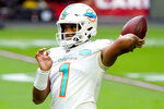 Miami Dolphins quarterback Tua Tagovailoa (1) warms up prior to an NFL football game against the Arizona Cardinals, Sunday, Nov. 8, 2020, in Glendale, Ariz. (AP Photo/Rick Scuteri)