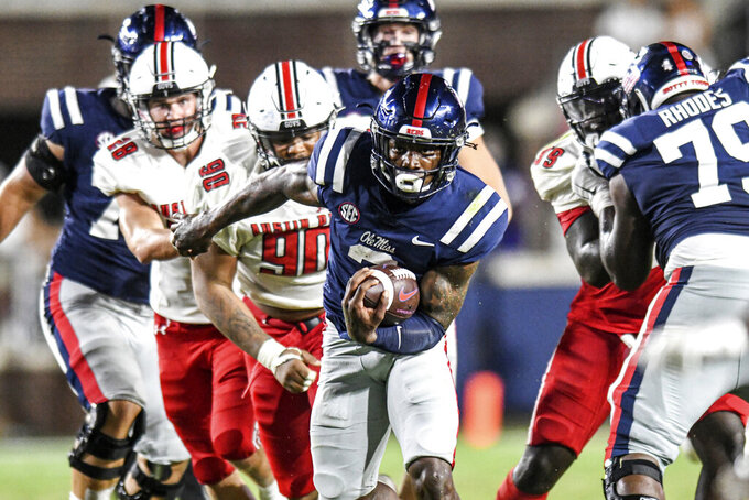 Mississippi running back Kentrel Bullock, center front, runs against Austin Peay during an NCAA college football game in Oxford, Miss., Saturday, Sept. 11, 2021. (AP Photo/Bruce Newman)